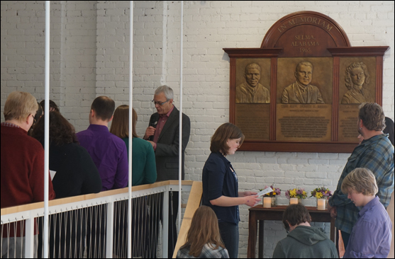 The Rev. Harlan Limpert leads UUA staff in reading a litany of rededication for a memorial to Jimmie Lee Jackson, the Rev. James Reeb, and Viola Liuzzo