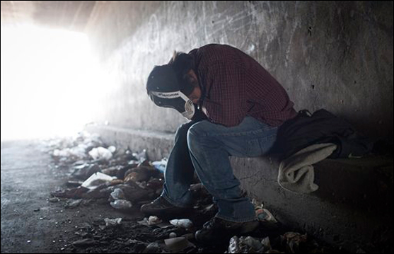 A homeless man tries to rest inside a Tijuana River canal tunnel, in Tijuana, Mexico, on June 22, 2011 (AP Photo/Alejandro Cossio).